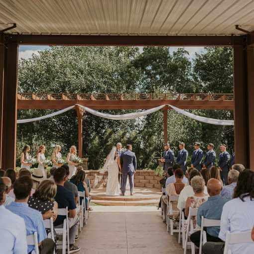 Wedding Couple under a Pavilion at A View on State